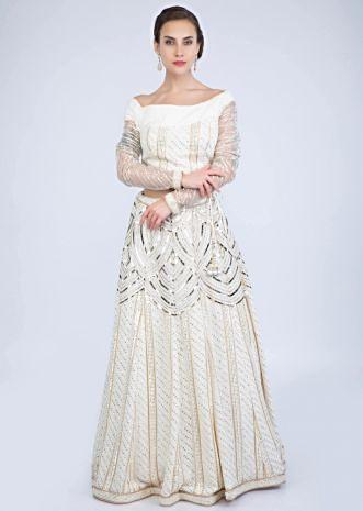 4e6e60b6965ef7 Off white thread embroidered lurex lehenga with one side off shoulder  matching blouse only on Kalki ...