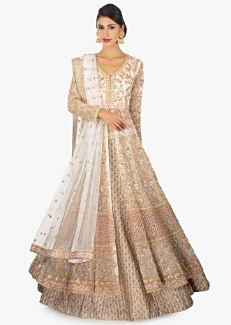 Off white zari lehenga paired with a long net embellished jacket