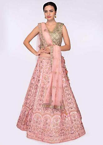 Olive green blouse paired with pink heavy embroidered lehenga and net dupatta