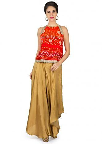 Orange bandhani top with dark beige fancy palazzo pant only on Kalki