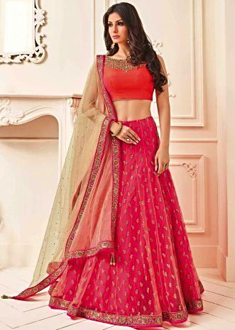 Orange and pink lehenga feautring with zari and embroidered neckline