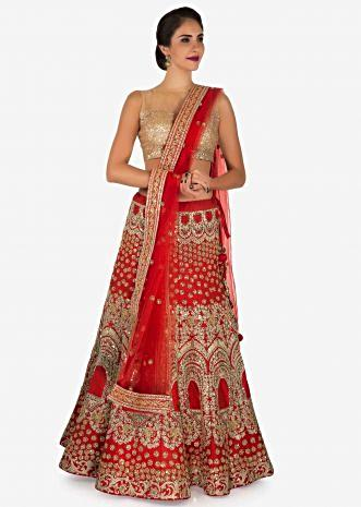 Orange lehenga in raw silk decorated in sequin and zari embroidered work only on Kalki