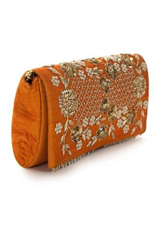 Orange sling bag embroidered in zari and sequin work only on Kalki