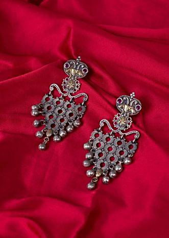 Oxidized silver coated earring with round cut outs only on Kalki