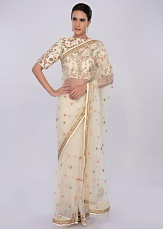 Pale lemon yellow net saree with floral embroidery and butti only on kalki