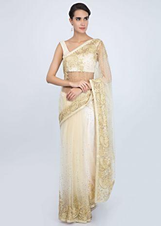 Pale yellow net saree with embroidered border and pallo only on Kalki