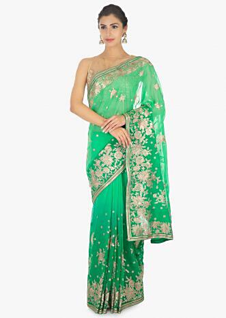 Parrot green georgette saree in zari embroidered floral butti and border