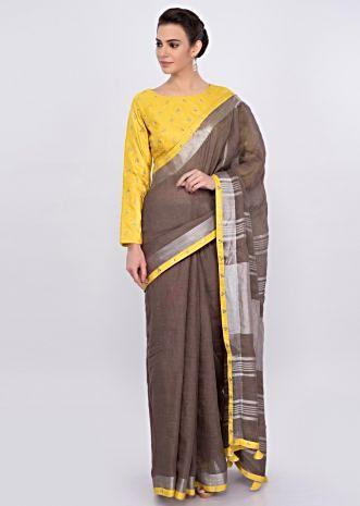 Pastel brown jute cotton saree with yellow border only on Kalki