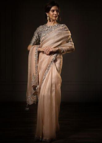 Pastel peach organza saree with contrasting grey blouse only on kalki