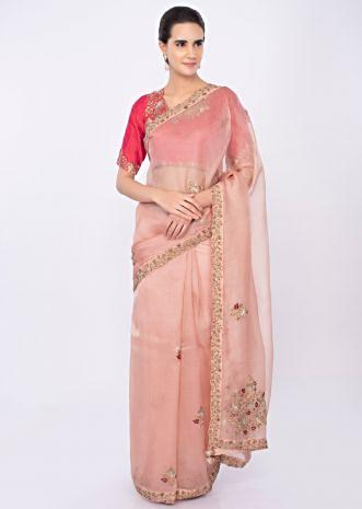 Pastel peach organza saree with coral pink raw silk blouse only on kalki