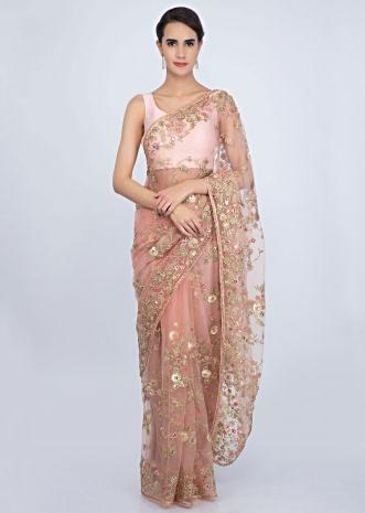Peach embroidered net saree with cord and thread jaal work only on Kalki