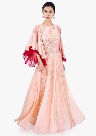 Peach georgette suit with over lapping sleeves and gathers from waistline