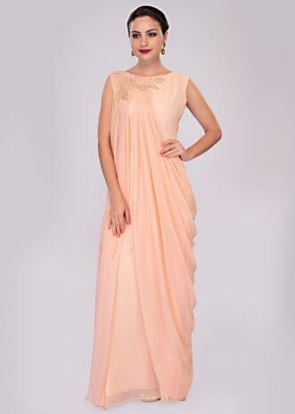 Peach georgette tunic dress enhanced with pleats and side cowl drape