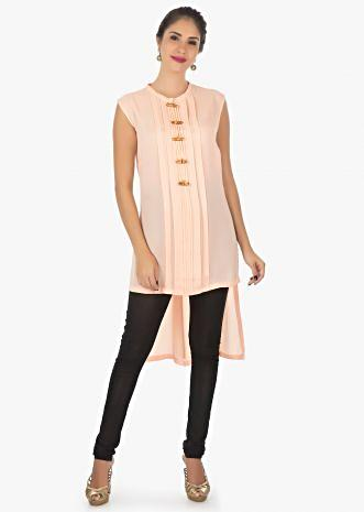 Peach kurti featuring in georgette with fancy buttons and pleats only on kalki
