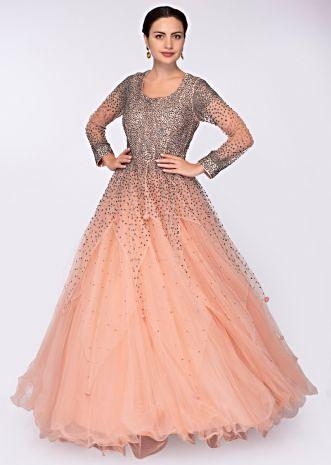 Peach multiple layer net gown with  handkerchief cut