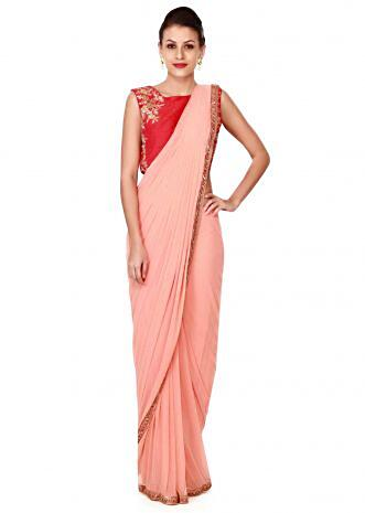 Peach pre stitched saree with embroidered blouse only on Kalki