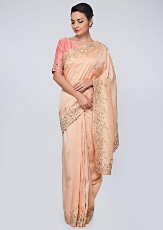 Peach raw silk saree in zari and sequins embroidered butti and border