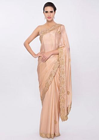 Peach satin chiffon saree in cut dana and gotta embroidery and butti only on Kalki