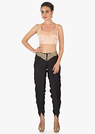 Peach satin crop top with a Black fancy dhoti pants only on kalki