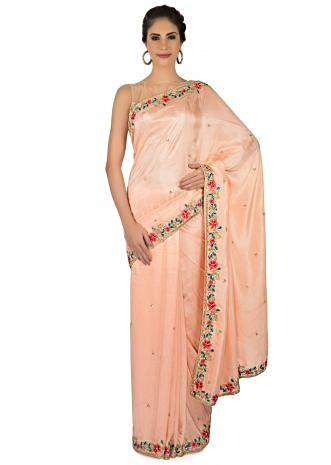Peach satin saree embellished in resham and moti embroidery in floral motif only on Kalki