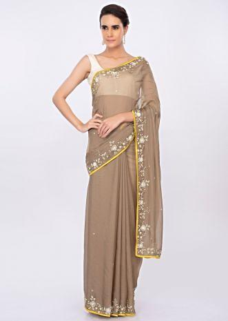 Peanut brown organza saree with floral embroidered border only on kalki