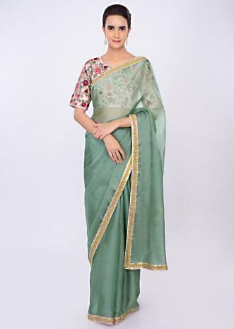 Persian green organza saree with pink floral embroidered blouse only on kalki