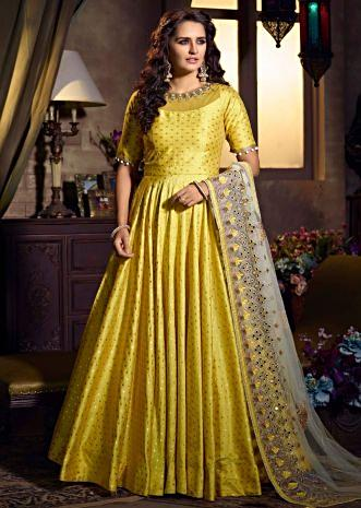 Pine yellow silk anarkali suit with weaved butti