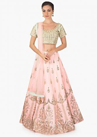 Pink lehenga with mint blouse and  a matching pink net dupatta with mint border only on Kalki