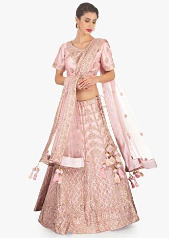 Pink raw silk embellished lehenga set paired with net  dupatta