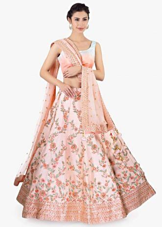 Pink  raw silk lehenga set paired with a matching net dupatta