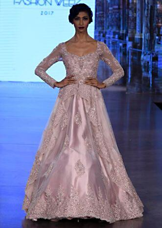 65de8efc7 Pink ballroom gown with centre frills and embroidery ...