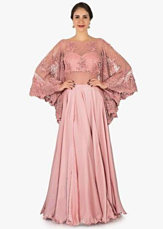 Pink gown in satin flaunting the bell sleeves embroidered with moti and chord work only on Kalki