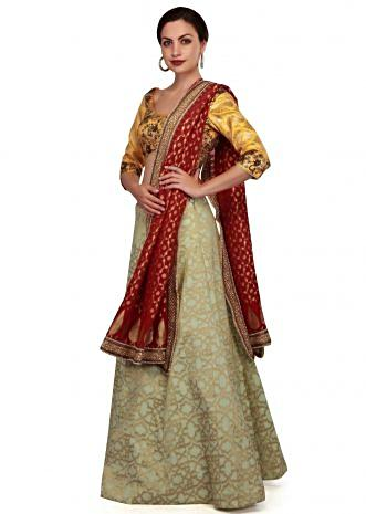 Pista green and yellow lehenga Choli with weaved dupatta only on Kalki