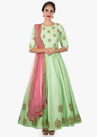 Pista green raw silk anarkali paired with contrasting pink net dupatta only on Kalki