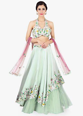 Pista green  lehenga paired with halter neck embroidered blouse and pink net dupatta