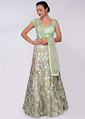 Pista green net lehenga with patch work paired with matching blouse and net dupatta only on Kalki