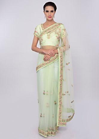 Pista green net saree in floral resham embroidery and butti only on Kalki