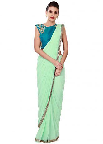 ‌Brook green pre stitched saree with embroidered blouse only on Kalki