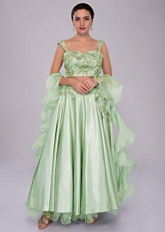 Pista green satin crepe lehenga and embroidered crop top with organza ruffled dupatta