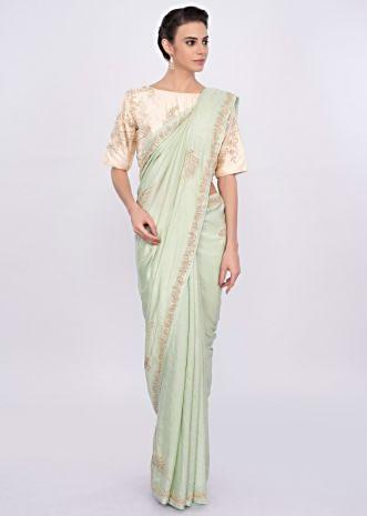 Pista green silk saree with cut dana and moti embroidery and butti only on Kalki