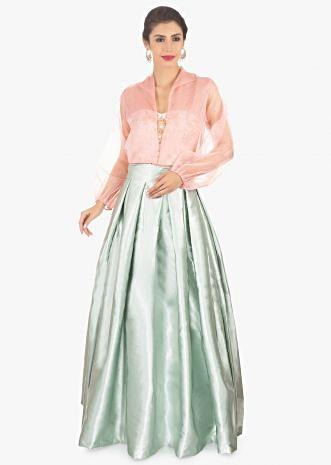 Pista green skirt paired with a strapless crop top and pink organza jacket