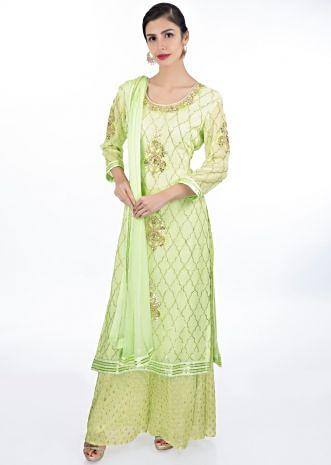 Pista green suit in moroccan motif paired with weaved palazzo and matching chiffon dupatta