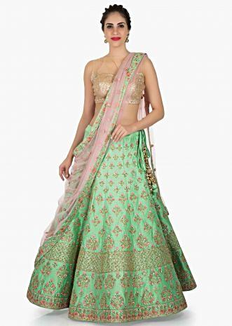 Pista green lehenga in raw silk embellished in resham and zari work only on Kalki