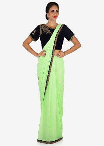 Pista green ready pleated saree in lycra beautified in zardosi embroidery work only on Kalki