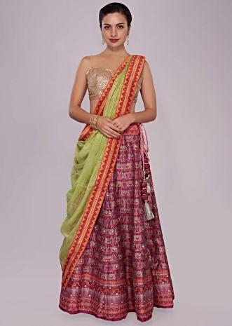 Plum silk lehenga in patola print with contrast border