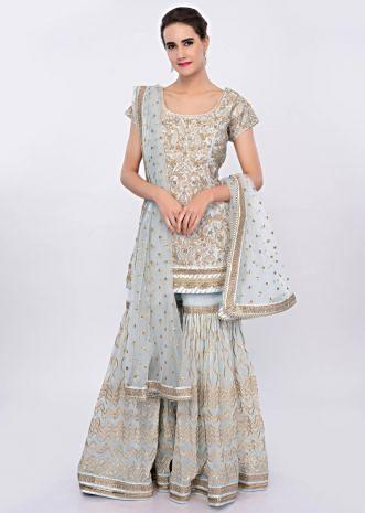 Powder blue sharara suit set in heavy lace jaal embroidery only on Kalki