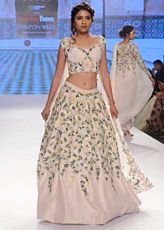 Powder pink hand and machine embroidered lehenga and corset with shoulder cape