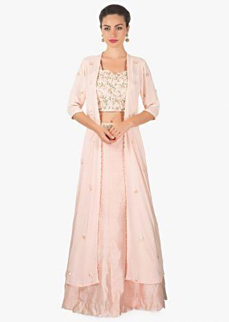 Powder pink lehenga matched with crop top blouse and long embroidered jacket