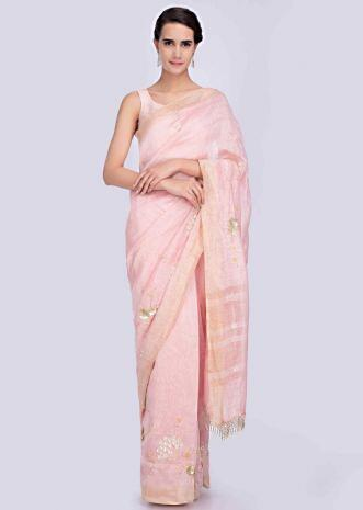 69a346f7288 Powder pink linen saree adorn with hand embellished butti and border only  on Kalki ...