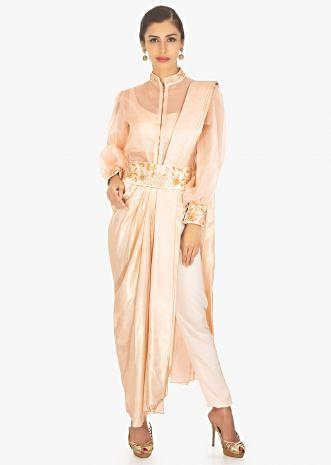 Powder pink saree with pants paired with matching crop top and fancy jacket